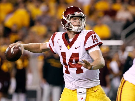 FILE - In this Saturday, Oct. 28, 2017 file photo, Southern California quarterback Sam Darnold throws a pass during the first half of an NCAA college football game against Arizona State in Tempe, Ariz. Southern California quarterback Sam Darnold will skip his final two seasons of eligibility to enter the NFL draft. (AP Photo/Ralph Freso, File)