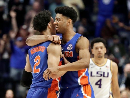 Florida guard Andrew Nembhard (2) and Jalen Hudson celebrated after beating LSU on Friday.