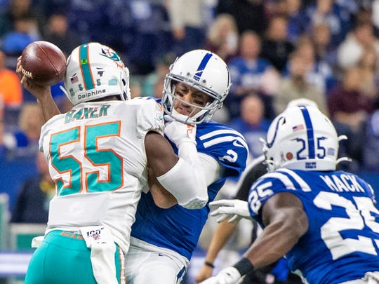 INDIANAPOLIS, IN - NOVEMBER 10: Jerome Baker #55 of the Miami Dolphins sacks Brian Hoyer #2 of the Indianapolis Colts during the second quarter at Lucas Oil Stadium on November 10, 2019 in Indianapolis, Indiana. (Photo by Bobby Ellis/Getty Images)