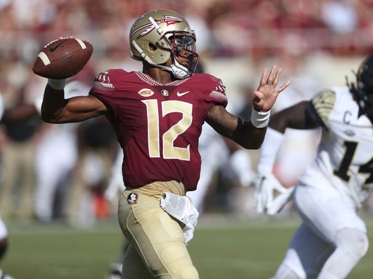 FSU's Deondre Francois throws the ball against Wake Forest during their game at Doak Campbell Stadium on Saturday. Francois scored the lone touchdown of the first half, on a 2-yard run.