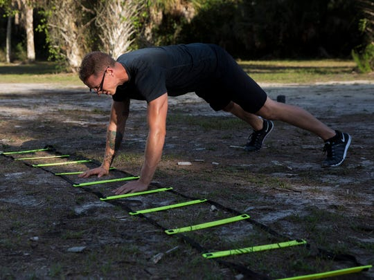 "Personal trainer Johnathan Blevins has taken years of fitness experience and created an engaging ""Boot Camp"" style program for those seeking a different type of exercise at Koreshan State Historic Site Monday, May 22, 2017 in Fort Myers, Fla. Blevins daily routines change from day to day but usually feature plenty of cardio."