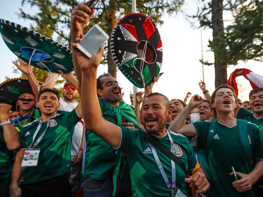 Mexico soccer fans celebrate their team's victory over Germany.