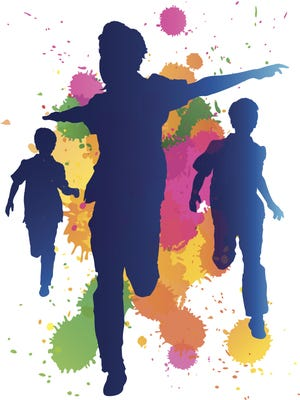 Young boys running against a paint splatter background