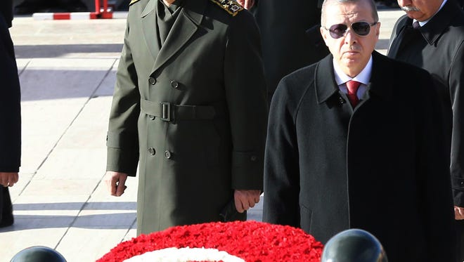 Turkish President Recep Tayyip Erdogan, host of the G-20 summit, lays a wreath on Nov. 10, 2015, at the  mausoleum of Mustafa Kemal Ataturk, founder of the Republic of Turkey, to mark the 77th anniversary of Ataturk's death.