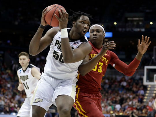 Purdue's Caleb Swanigan (50) drives against Iowa State's Solomon Young (33) during the first half of an NCAA college basketball tournament second-round game Saturday, March 18, 2017, in Milwaukee. (AP Photo/Morry Gash)