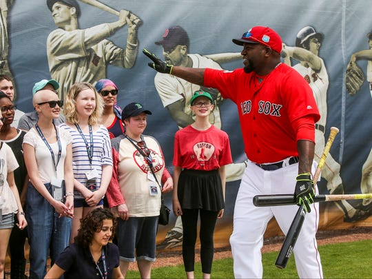 Red Sox David Ortiz waves to the kids after he took