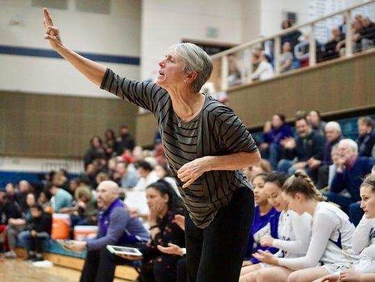 North Kitsap girls basketball coach Penny Gienger signals