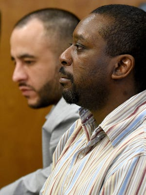 Defendants Christen Ramirez and Marcelluis Luckie listen to opening statements Tuesday afternoon in Judge Brent Robinson's courtroom.
