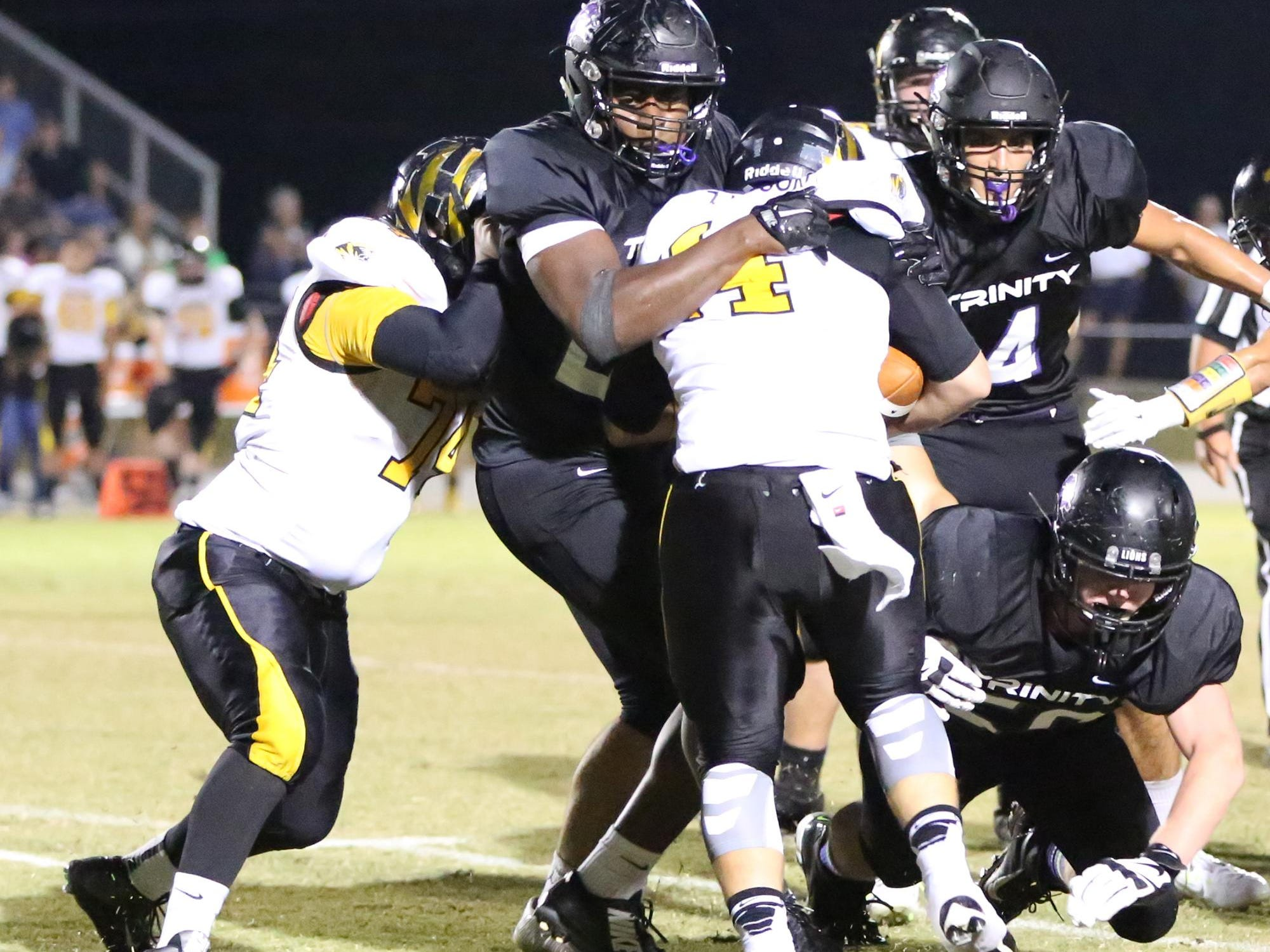 TCA's Chris Tucker wraps up the Halls ball carrier for a tackle when they played in Week 5 of the regular season.