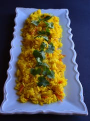 This lovely turmeric rice pilaf is fluffy, savory and flavorful.