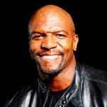 """FILE - This Sept. 19, 2013 file photo shows actor and former NFL player Terry Crews in New York. Crews is replacing Cedric """"The Entertainer"""" as new host of the game show """"Who Wants To Be a Millionaire."""" The actor, former NFL player and Old Spice pitchman will join the weekday game show starting this fall, according to its studio, Disney-ABC Domestic Television. (Photo by Dan Hallman/Invision/AP, File) ORG XMIT: NYET321"""