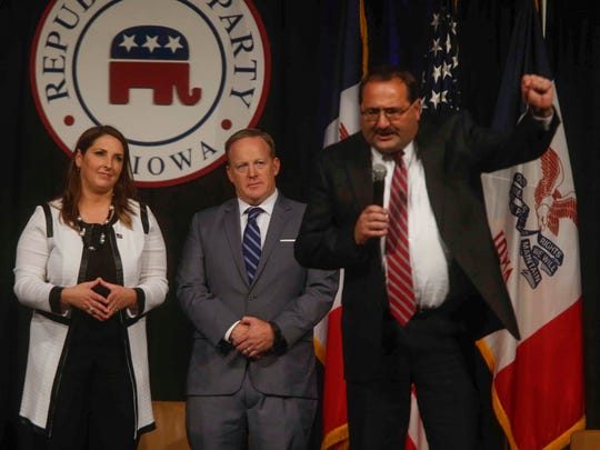 RNC Chairwoman Ronna Romney McDaniel and former White House Press Secretary Sean Spicer watch as Jeff Kaufmann, chairman for the Iowa Republican Party, speaks after concluding a question and answer session during the 2017 GOP Reagan Dinner on Wednesday, Nov. 8, 2017, in Des Moines