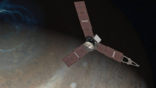 This artist depiction shows what the Juno spacecraft may look like above Jupiter's north pole.