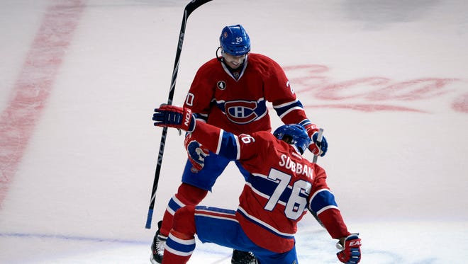 Montreal Canadiens defenseman P.K. Subban (76) reacts with teammate Manny Malhotra (20) after scoring the winning goal during the overtime period against the Nashville Predators at the Bell Centre during the 2014-15 season.