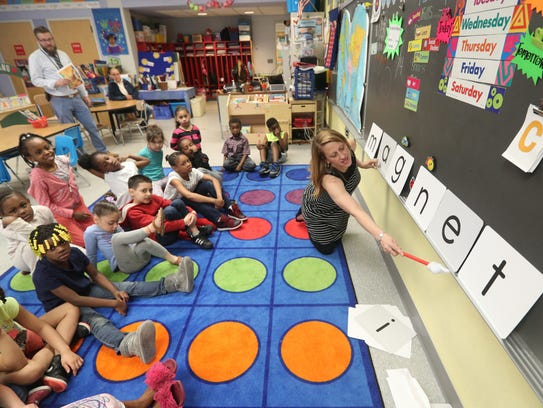 Jen Codispoti working with her first-grade students