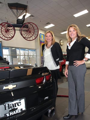 Courtney Cole, left, and Monica Peck, shown on Tuesday, Oct. 30, 2012, at Hare Chevrolet in Noblesville.