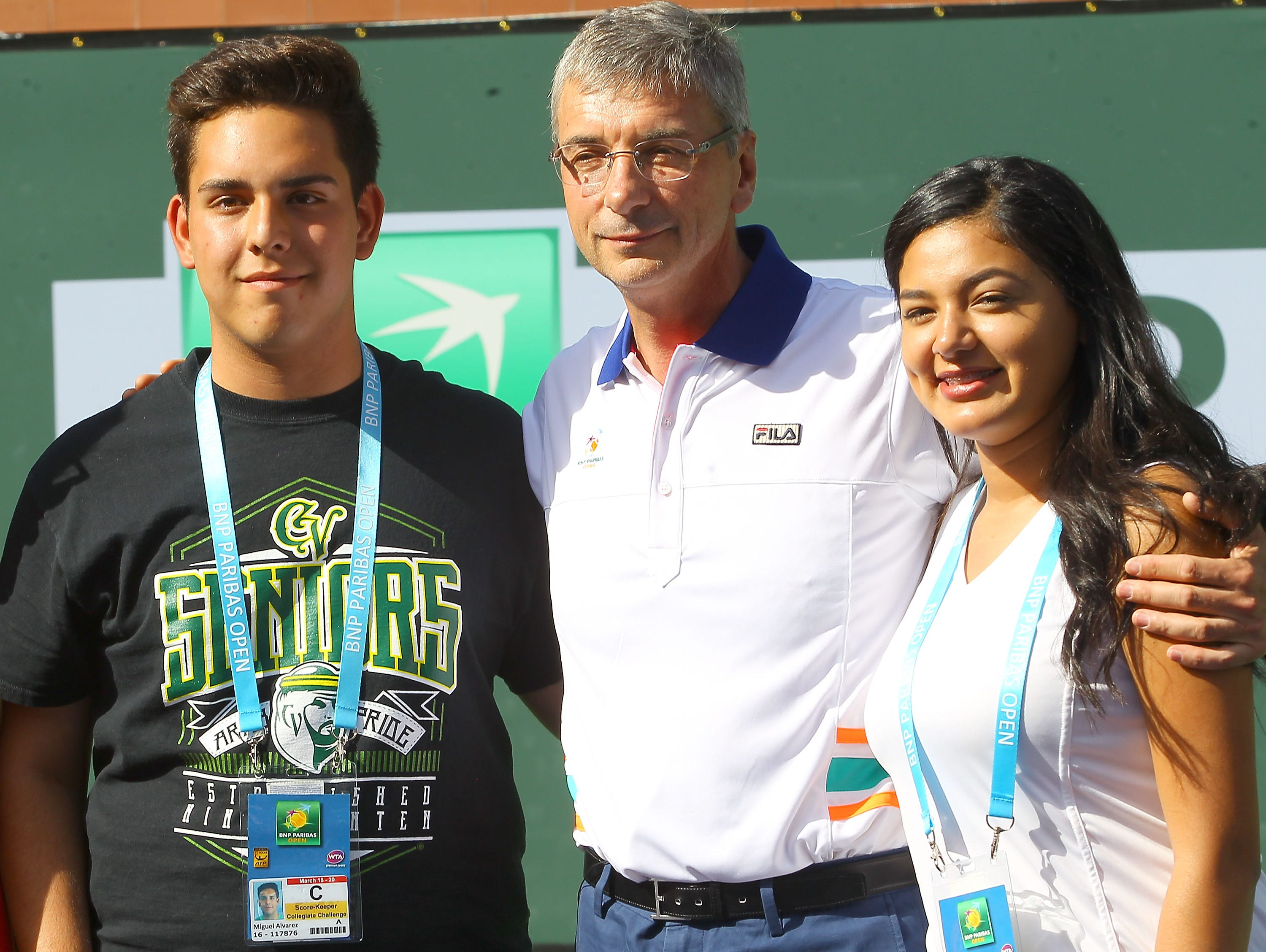 Scholarship recipients and Coachella Valley High School students Miguel Alvarez and Brianda Beltran pose for a photo with Jean Laurent-Bonnafe at the BNP Paribas Open in Indian Wells, March 19, 2016.