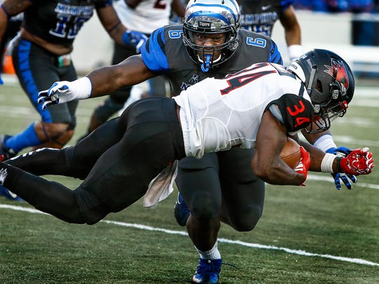September 3, 2016 - Memphis linebacker Genard Avery (back) looks to bring down Southeast Missouri State running back Will Young (front) during second quarter action at Liberty Bowl Memorial Stadium.  (Mark Weber/The Commercial Appeal)