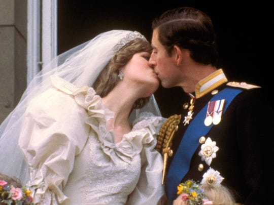 Newlyweds Charles and Diana finally remember to kiss