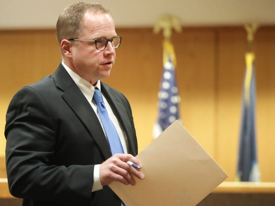 Winnebago County Deputy District Attorney Scott Ceman gives his opening statement during the competency phase in the trial of Brian T. Flatoff. Ceman, who worked as a prosecutor for 14 years, recently resigned out of frustration with the low wages paid to prosecutors in Wisconsin.
