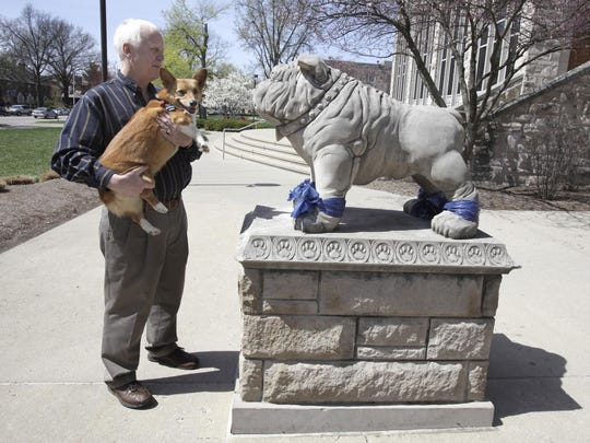Jim Walsh of Overland Park, Kansas takes his dog Bella