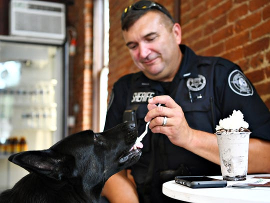 Lt. David Godfrey, right, shares a bite of his own