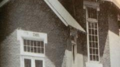An enlarged photo of Reed School is on display at the museum.