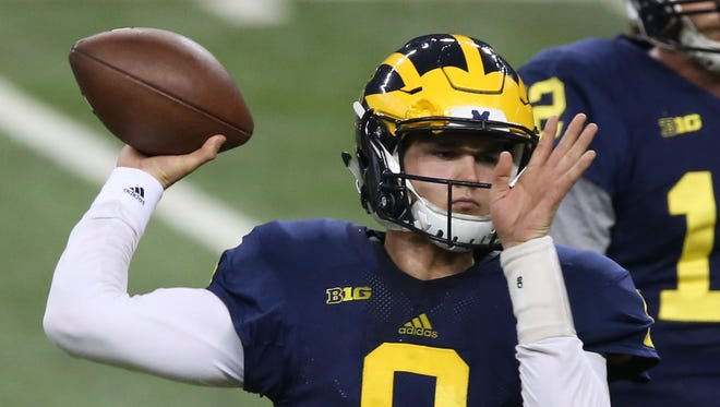 Michigan Wolverines QB John O'Korn throws passes during spring practice Saturday, March 26, 2016 at Ford Field in Detroit, MI.