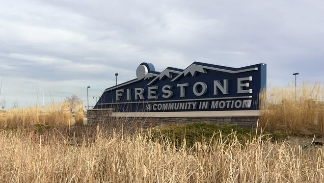 A sign welcomes residents and visitors to the fast-growing northern Colorado town of Firestone, which has reported repeated violations of lead action levels in homes in the town's oldest neighborhoods.