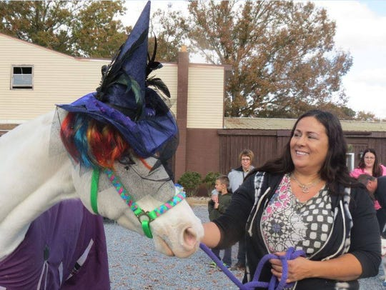 Ice, a horse, was entered in a pet costume contest