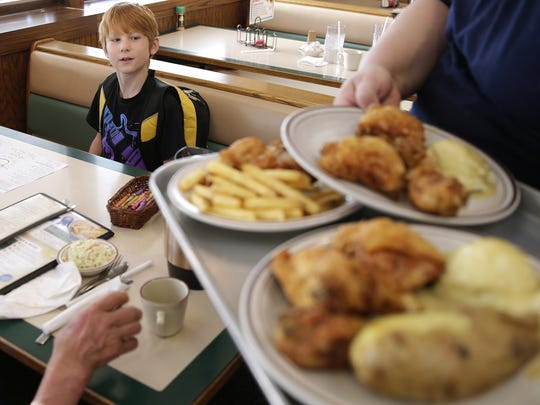 In this archived photo from 2015, Michael Steffens, then 9, watches as food is brought to the table at Mary's Family Restaurant.