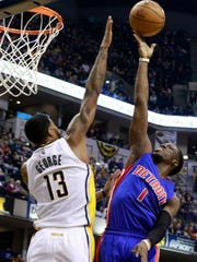 Pistons guard Reggie Jackson (1) shoots the ball defended by Pacers forward Paul George in the first half of the Pistons' 105-84 loss Saturday in Indianapolis.