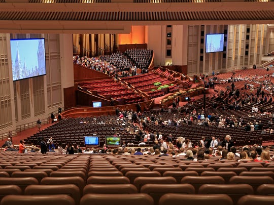 Members of The Church of Jesus Christ of Latter-day Saints gather Saturday inside the church's Conference Center in Salt Lake City as they attend the Semiannual General Conference.