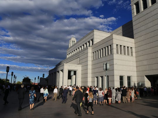 Members of The Church of Jesus Christ of Latter-day Saints gather Sunday morning at the Confereence Center in Salt Lake City for the church's Semiannual General Conference.