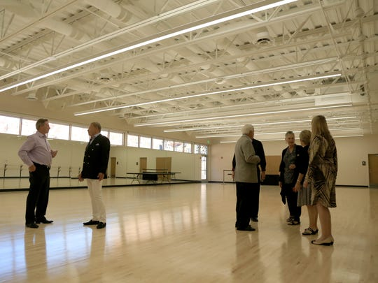 Visitors tour the Entrada Dance Studio on Friday after
