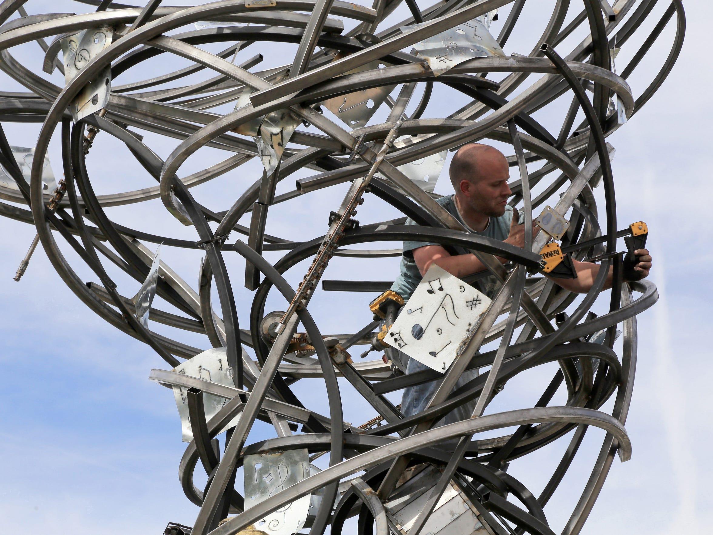 "Artist Deveren B. Farley installs his ""Silly Symphony"""