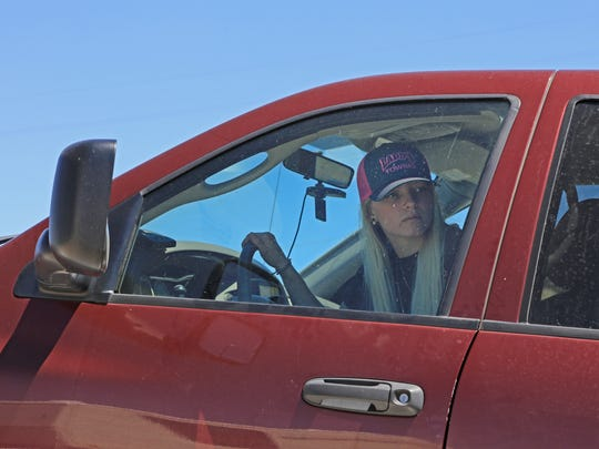 Jessi Brindley backs a pickup off of a tow truck Wednesday