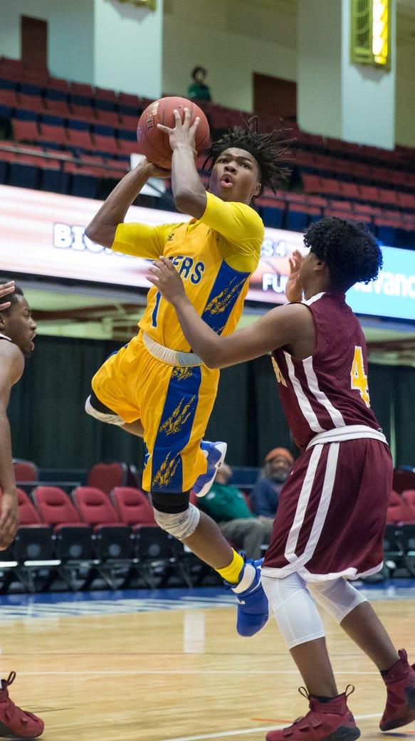 MLK's Romello Faison drives to the basket as Biondi's