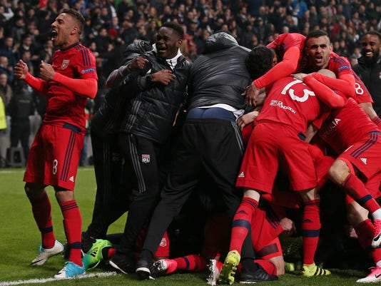 Lyon players celebrate at the end of a penalty shootout during a Europa League quarterfinal, second leg soccer match between Besiktas and Lyon in Istanbul, Turkey, Thursday April 20, 2017. The match finished 3-3 on aggregate with Lyon winning the tie after extra time and penalties.(AP Photo/Emrah Gurel)