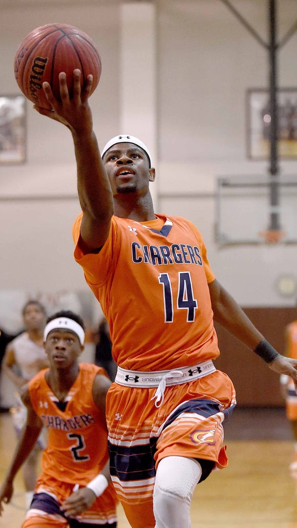 On a fast break, Callaway's Malik Newman (14) lays the ball up against the backboard for trailing teammate Marcus Summerville (2) on Monday, January 19, 2015, at Lanier High School. Newman had 32 of his 42 points in the first half.