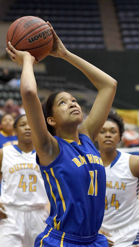 Bay High's Simone Jackson (11) gets behind two Quitman defenders for an uncontested layup on Wednesday, March 11, 2015, in the MHSAA State Basketball Tournament semifinals at the Mississippi Coliseum on the Mississippi State Fairgrounds in Jackson, Miss.
