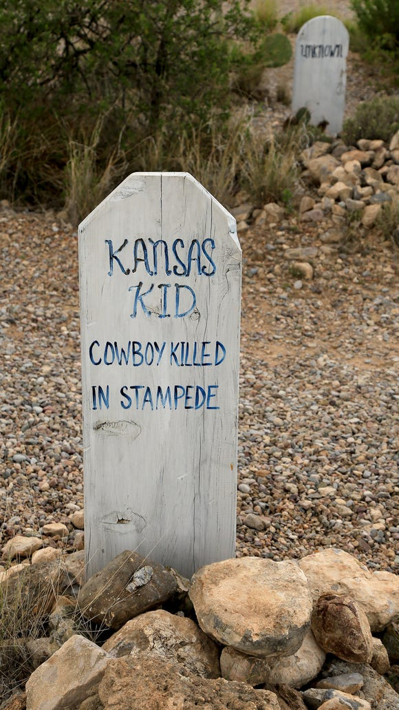 The grave markers tell sad stories of the Wild West