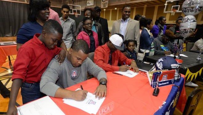 Calvary's Orlando Bradford (left) and Shun Brown (right) sign with Arizona