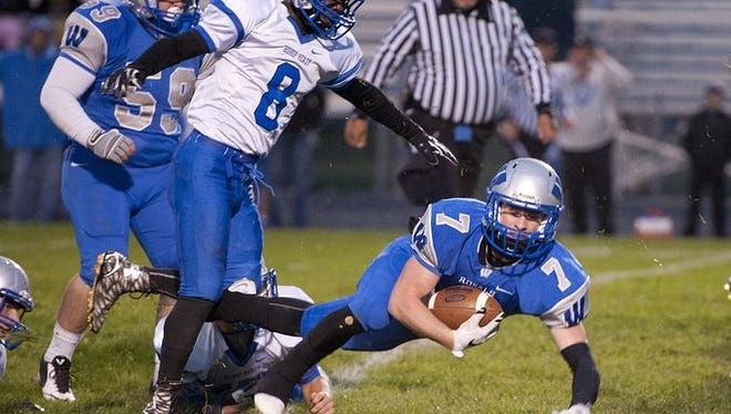 Wynford running back Nick Looker dives forward for a first down Friday against Bishop Ready.