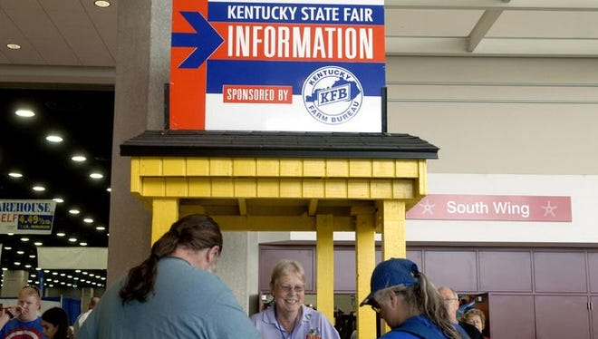 Charlotte Dunbar helps out at an information booth on the opening day of the Kentucky State Fair.
