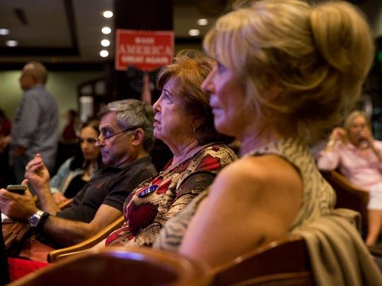 Attendees react while watching the final Presidential debate between Republican nominee Donald Trump and Democratic nominee Hillary Clinton at the Tiburon Golf Club Wednesday, October 19, 2016.