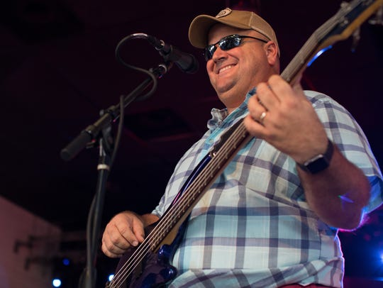 Kirby Warnke plays bass with Hard At Play at Brewster