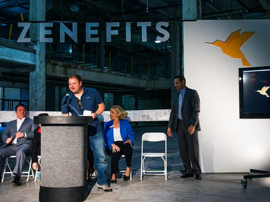 Zenefits, an online human resources company, is opening offices in Scottsdale. Plans are for the company to add up to 1,300 jobs over three years. Parker Conrad, Zenefits CEO, makes a comment at the podium.