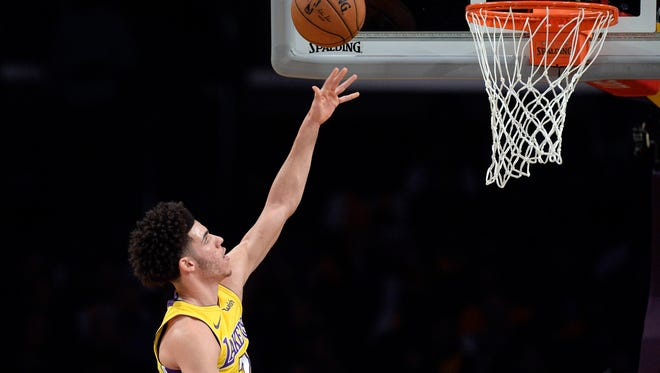 Lonzo Ball scores a basket against the Toronto Raptors during the first half at Staples Center.