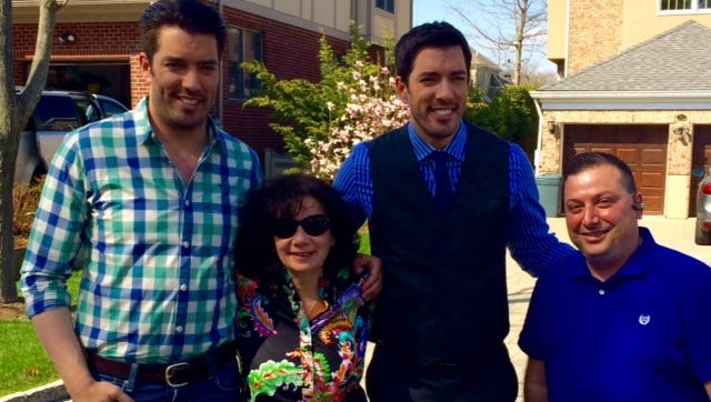 Property Brothers Jonathan and Drew Scott with Lorenzo Signorile of Tri-Crest Realty and Linda Critelli, the mother of one of the owners of the Eastchester dream home.